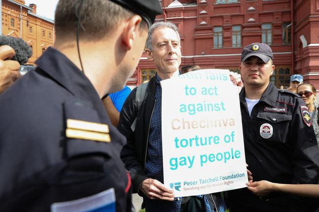 Tatchell is questioned and led away by Russian authorities in Moscow after staging a one-man protest near Red Square.