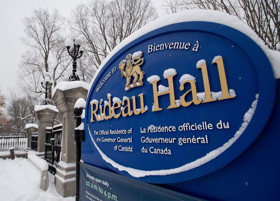 A sign along the wall surrounding Rideau Hall is seen on Jan. 21, 2021 in Ottawa. Gov. Gen. Julie Payette is resigning. The news comes as the results of an investigation into allegations of a toxic workplace environment at Rideau Hall are expected to be released. (Photo: CP/Adrian Wyld)
