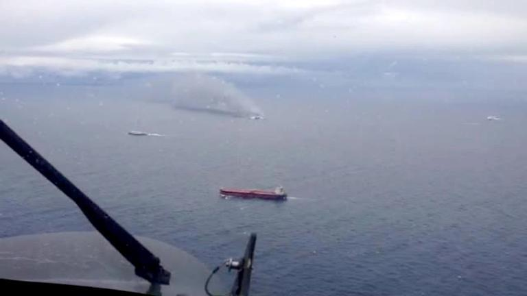 """A photo grab taken from a video made available by the Aeronautica Militare Italiana on December 28, 2014, shows the burning ferry """"Norman Atlantic"""" adrift off Albania"""