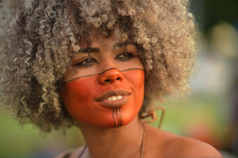 An indigenous woman pictured at the protest is among more than 800,000 indigenous people and more than 300 tribes in Brazil, according to the country's FUNAI indigenous affairs agency (AFP Photo/CARL DE SOUZA)