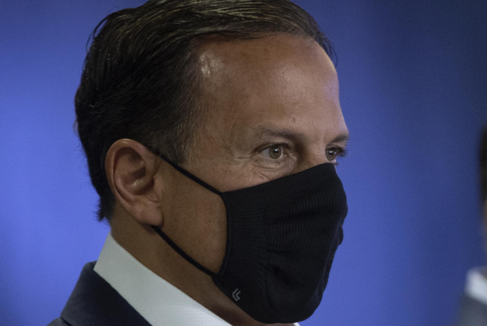 Sao Paulo Governor Joao Doria attends a press conference presenting an experimental COVID-19 vaccine that is being tested in partnership with China's pharmaceutical company Sinovac in Sao Paulo, Brazil, Monday, Nov. 9, 2020. (AP Photo/Andre Penner)
