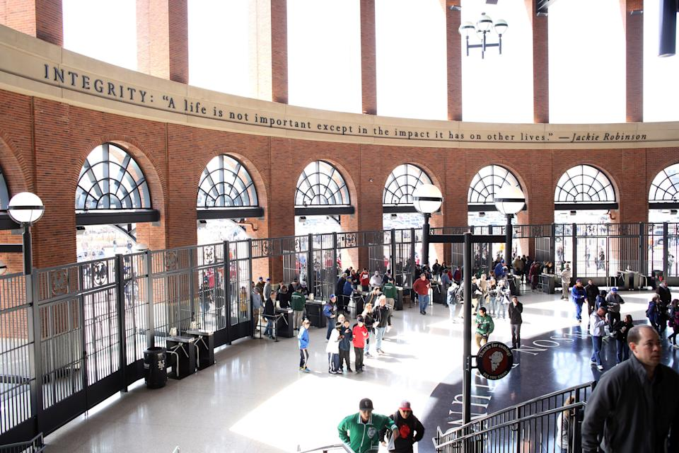 Fans arrive for the ball game inside the entrance to Citi Field, which features the Jackie Robinson Rotunda, during the New York Mets V San Diego Padres Baseball game at Citi Field, Queens, New York. 5th April 2012. Photo Tim Clayton (Photo by Tim Clayton/Corbis via Getty Images)