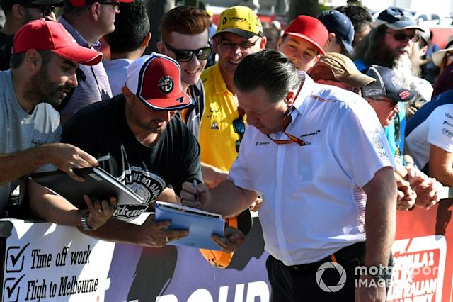 "Zak Brown, Executive Director, McLaren signs autographs for fans. <span class=""copyright"">Mark Sutton / Motorsport Images</span>"