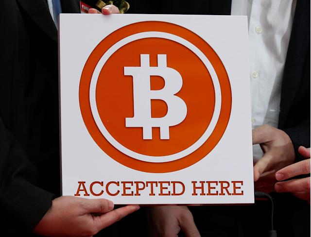 Accepting Bitcoin requires figuring out a strategy to deal with the risk. REUTERS/Bobby Yip/File Photo