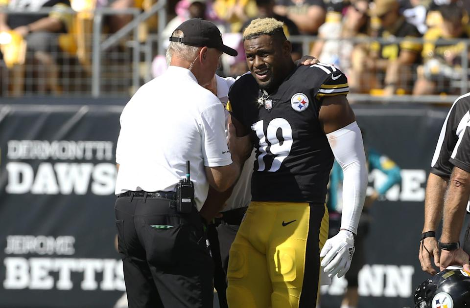 Pittsburgh Steelers WR JuJu Smith-Schuster (19) grimaces after suffering an injury against the Denver Broncos,