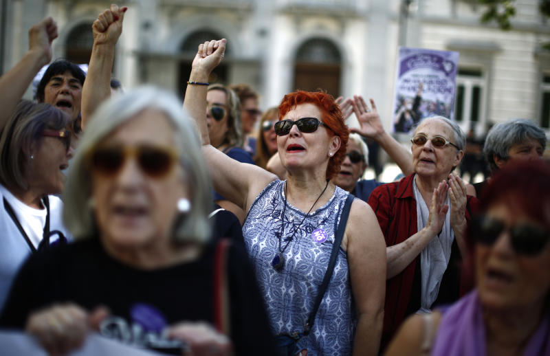 "Women protest after Spain's top court found five men known as the ""La Manada,"" or ""The Animal Pack"" guilty of rape outside the Supreme Court in Madrid, Spain, Friday, June 21, 2019. Spain's Supreme Court on Friday overruled two lower courts and sentenced five men to 15 years in prison each for raping an 18-year-old woman. (AP Photo/Manu Fernandez)"