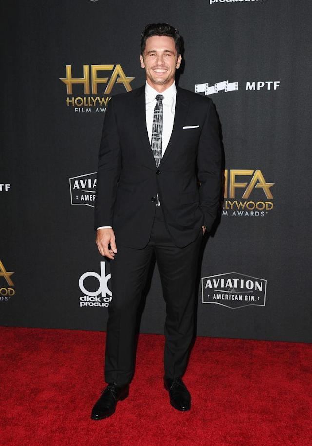 <p>The actor looked quite matchy-matchy in a Dior Homme suit and Salvatore Ferragamo shoes. (Photo: Getty Images) </p>