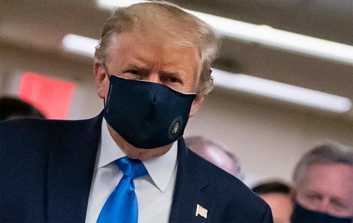 President Donald Trump finally wears a mask as he visits Walter Reed National Military Medical Center in Bethesda, Maryland, on July 11, 2020. (Photo: ALEX EDELMAN via Getty Images)