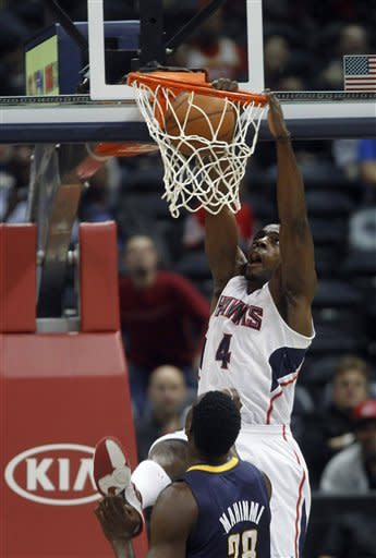 Atlanta Hawks power forward Anthony Tolliver (4) scores as Indiana Pacers center Ian Mahinmi (28) defends in the first half of an NBA basketball game on Wednesday, Nov. 7, 2012, in Atlanta. (AP Photo/John Bazemore)