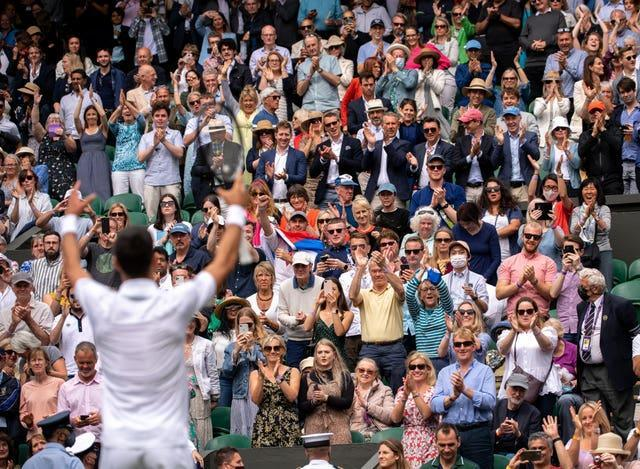 Novak Djokovic signals to the crowd after his victory