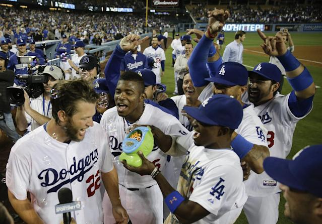 Los Angeles Dodgers starting pitcher Clayton Kershaw, left, celebrates his no hitter with his teammates against the Colorado Rockies after a baseball game in Los Angeles, Wednesday, June 18, 2014. (AP Photo/Chris Carlson)