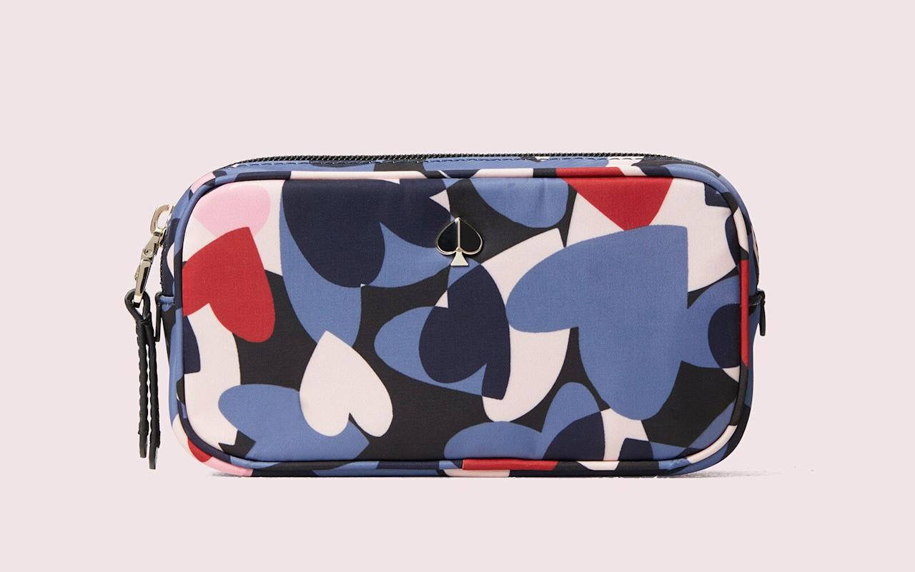 "<p>A compact yet spacious makeup bag with a cute pattern isn't hard to find if you turn to Kate Spade. This case features an easy-to-clean nylon lining and several interior slip pockets, so you'll never have to dig through your bag to find your favorite lipstick again. </p> <p>To buy: <a href=""https://click.linksynergy.com/deeplink?id=93xLBvPhAeE&mid=42608&murl=https%3A%2F%2Fwww.katespade.com%2Fproducts%2Ftaylor-heart-party-small-cosmetic-case%2FPWRU7737.html&u1=TL%2CThe19BestTravelMakeupBagstoPackonYourNextTrip%2Cszypulsr%2CBEA%2CGAL%2C562526%2C202001%2CI"" target=""_blank"">katespade.com</a>, $58</p>"