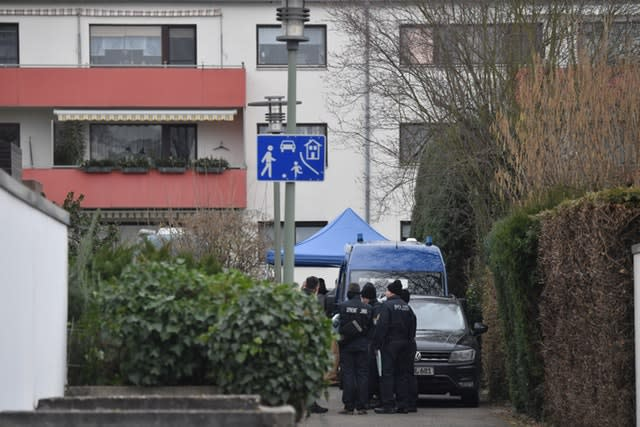 Police officers at the house where the suspected perpetrator was found dead after a series of deadly shootings in Hanau, Germany
