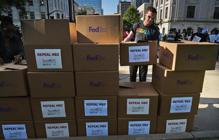 Stacking boxes of petitions against House Bill 2