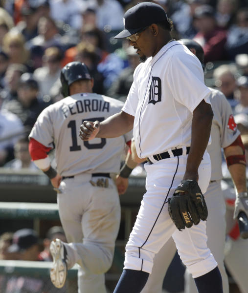 Detroit Tigers relief pitcher Jose Valverde backs back to the mound as Boston Red Sox runner Dustin Pedroia scores on a sacrifice fly by teammate David Ortiz during a baseball game in Detroit, Thursday, April 5, 2012. (AP Photo/Carlos Osorio)
