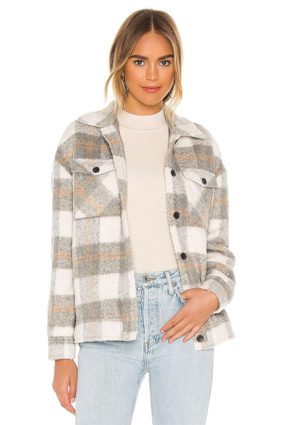 """<p><strong>SAYLOR</strong></p><p>revolve.com</p><p><strong>$286.00</strong></p><p><a href=""""https://go.redirectingat.com?id=74968X1596630&url=https%3A%2F%2Fwww.revolve.com%2Fdp%2FSAYR-WO8%2F&sref=https%3A%2F%2Fwww.cosmopolitan.com%2Fstyle-beauty%2Ffashion%2Fg37222274%2F7th-anniversary-gift-ideas%2F"""" rel=""""nofollow noopener"""" target=""""_blank"""" data-ylk=""""slk:Shop Now"""" class=""""link rapid-noclick-resp"""">Shop Now</a></p><p>The shirt-jacket trend is going strong, my friends. And this plaid one is just way too good to pass up.</p>"""
