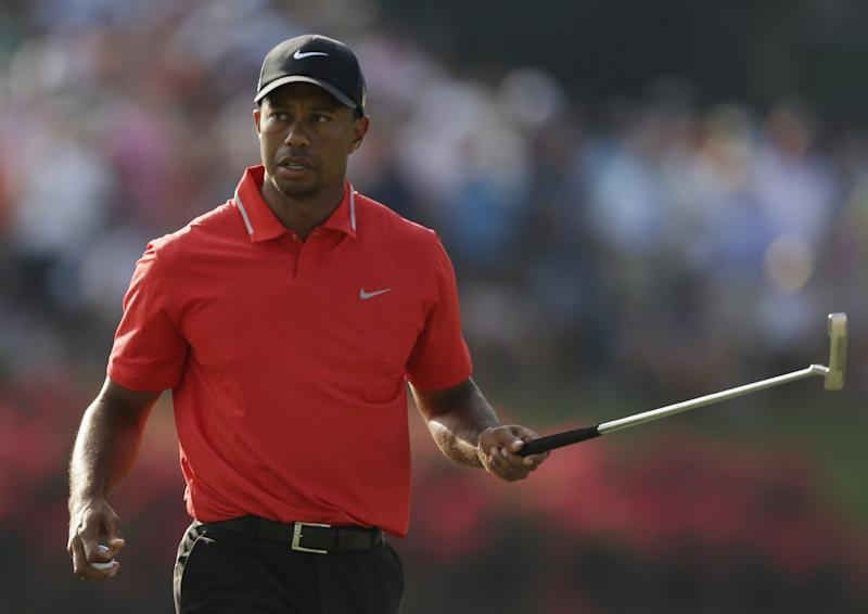 Tiger Woods looks toward the crowd as he makes par on the 17th hole during the final round of The Players championship golf tournament at TPC Sawgrass, Sunday, May 12, 2013, in Ponte Vedra Beach, Fla. TIger Woods won The Players Championship. (AP Photo/John Raoux)