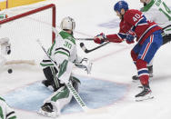 Montreal Canadiens' Joel Armia scores against Dallas Stars goaltender Ben Bishop during the first period of an NHL hockey game Saturday, Feb. 15, 2020, in Montreal. (Graham Hughes/The Canadian Press via AP)
