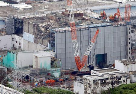 FILE PHOTO: An aerial view shows the No.3 reactor building at Tokyo Electric Power Co. (TEPCO)'s tsunami-crippled Fukushima Daiichi nuclear power plant in Fukushima Prefecture, in this photo taken by Kyodo July 18, 2013. Mandatory credit Kyodo/via REUTERS/File photo