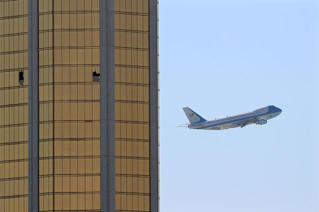 <p>OCT. 4, 2017 – Air Force One departs Las Vegas past the broken windows on the Mandalay Bay hotel, where shooter Stephen Paddock conducted his mass shooting along the Las Vegas Strip in Las Vegas, Nevada. (Photo: Mike Blake/Reuters) </p>