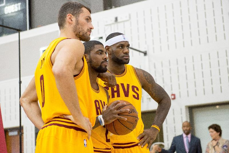 (L-R) Kevin Love, Kyrie Irving and LeBron James of the Cleveland Cavaliers pose for a photo during media day at Cleveland Clinic Courts on September 26, 2014 in Independence, Ohio (AFP Photo/Jason Miller)