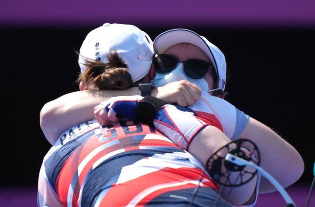 Great Britain's Phoebe Paterson Pine, back to camera, is congratulated by Jess Stretton