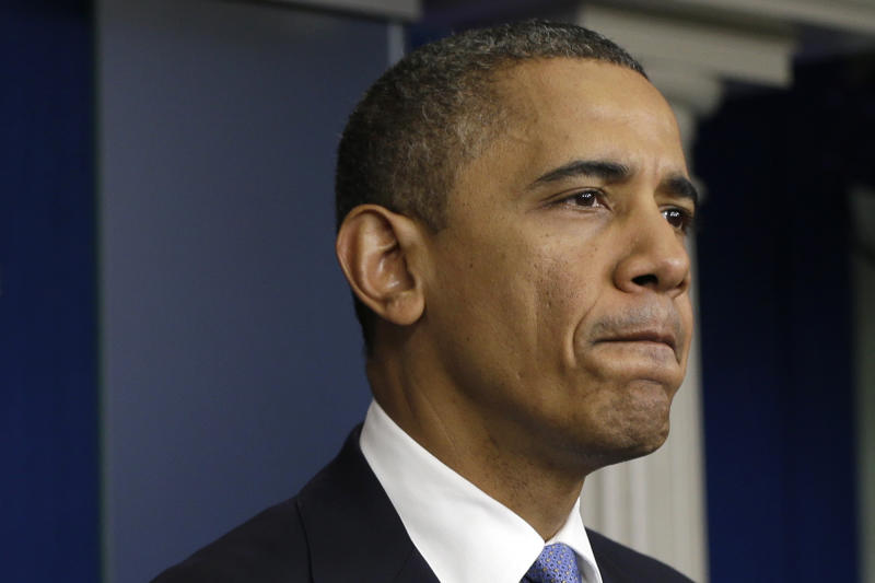 President Barack Obama pauses in the White House Briefing Room in Washington, on Monday, Oct. 29, 2012, where he spoke after returning to the White House from a campaign stop in Florida to monitor Hurricane Sandy. (AP Photo/Jacquelyn Martin)