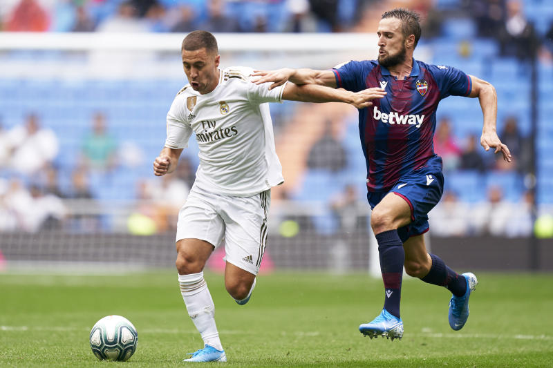 MADRID, SPAIN - SEPTEMBER 14: Eden Hazard of Real Madrid competes for the ball with Jorge Miramon of Levante UD during the La Liga match between Real Madrid CF and Levante UD at Estadio Santiago Bernabeu on September 14, 2019 in Madrid, Spain. (Photo by Quality Sport Images/Getty Images)