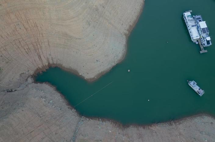 """<div class=""""inline-image__caption""""><p>Grounds marked with previous water levels at Oroville Lake in Oroville, California, U.S., on Tuesday, June 22, 2021. Kyle Grillot/Bloomberg via Getty Images""""</p></div> <div class=""""inline-image__credit"""">Bloomberg</div>"""