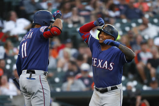 Texas Rangers' Willie Calhoun, right, celebrates his solo home run with Ronald Guzman in the fifth inning of a baseball game against the Detroit Tigers in Detroit, Wednesday, June 26, 2019. (AP Photo/Paul Sancya)