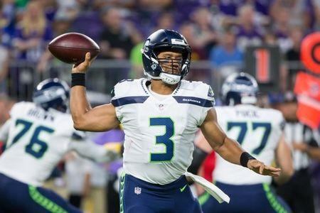 Aug 24, 2018; Minneapolis, MN, USA; Seattle Seahawks quarterback Russell Wilson (3) throws in the second quarter against Minnesota Vikings at U.S. Bank Stadium. Mandatory Credit: Brad Rempel-USA TODAY Sports