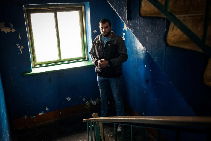Sergei Dylevsky in the hallway of his apartment building in Minsk, Belarus, Aug. 20, 2020. (Misha Friedman/The New York Times)