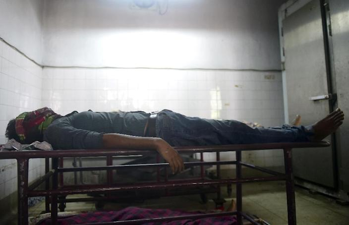 The body of Bangladeshi blogger Washiqur Rahman, lies in a morgue at Dhaka Medical College in Dhaka on March 30, 2015, after he was killed in an attack in the Bangladeshi capital (AFP Photo/Munir Uz Zaman)