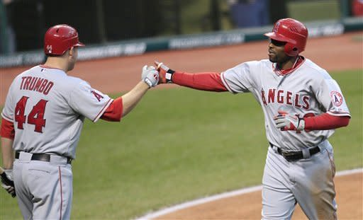 Los Angeles Angels' Torii Hunter, right, is congratulated by teammate Mark Trumbo after hitting a solo home run off Cleveland Indians starting pitcher Justin Masterson in the fourth inning in a baseball game on Friday, April 27, 2012, in Cleveland. (AP Photo/Tony Dejak)