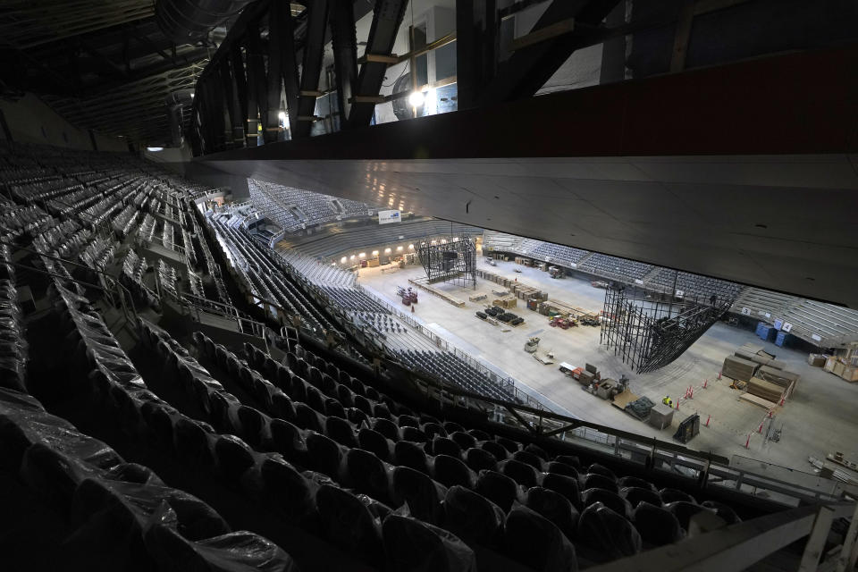 The ice and upper seating areas of Climate Pledge Arena are viewed during a media tour of the facility, Monday, July 12, 2021, in Seattle. The arena will be the home of the NHL hockey team Seattle Kraken and the WNBA Seattle Storm basketball team as well as hosting concerts and other performing arts events. (AP Photo/Ted S. Warren)
