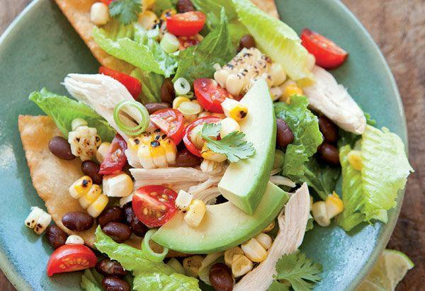 """The beauty of chicken salad isn't just that it's a completely different iteration of leftover roast chicken after eating it hot the night before -- it's also that you can adapt it based on whatever you have on hand. If you don't have corn or black beans, swap in any other veggies, from pieces of lightly cooked asparagus to canned artichoke hearts. Or, skip the tostadas in this recipe and throw in tortilla chips. And any vinaigrette will work, too. <br><br> <strong>Get the recipe: <a href=""""http://www.oprah.com/food/Chicken-Tostada-Salad-Recipe"""" rel=""""nofollow noopener"""" target=""""_blank"""" data-ylk=""""slk:Chicken Salad"""" class=""""link rapid-noclick-resp"""">Chicken Salad</a></strong>"""