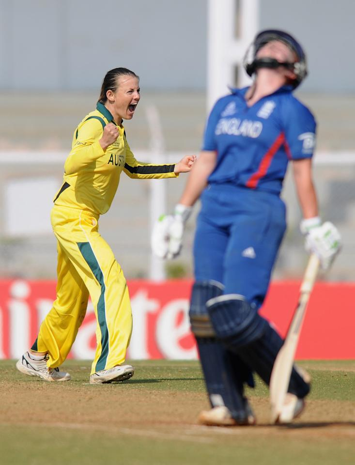 MUMBAI, INDIA - FEBRUARY 08:  Erin Osborne of Australia celebrates the wicket of Anya Shrubsole of England during the super six match  between England and Australia held at the CCI (Cricket Club of India)  on February 8, 2013 in Mumbai, India.  (Photo by Pal Pillai/Getty Images)