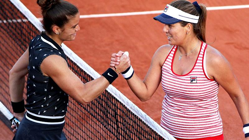 Maria Sakkari and Anna Tatishvili after their match. (Photo by Adam Pretty/Getty Images)
