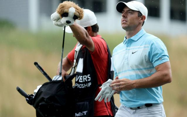Rory McIlroy walks towards the green - GETTY IMAGES