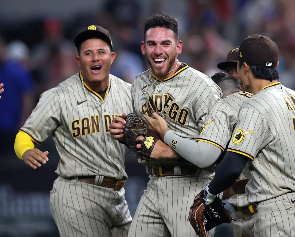 Joe Musgrove celebrates with teammates after throwing the first no-hitter in Padres history and first of the 2021 MLB season.