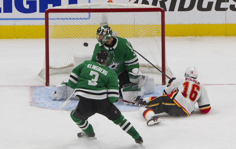 Calgary Flames' Tobias Rieder (16) scores on Dallas Stars goalie Ben Bishop (30) as John Klingberg (3) defends during the third period of a first round NHL Stanley Cup playoff hockey series in Edmonton, Alberta, on Thursday, Aug. 13, 2020. (Jason Franson/The Canadian Press via AP)
