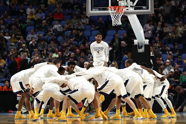<p>The West Virginia Mountaineers huddle up prior to their game against the Bucknell Bison during the first round of the 2017 NCAA Men's Basketball Tournament at KeyBank Center on March 16, 2017 in Buffalo, New York. (Photo by Elsa/Getty Images) </p>