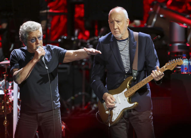 CORRECTS TO CONCERT IN DALLAS IS NOW CANCELLED In this Wednesday, Sept. 18, 2019 photo, Roger Daltrey and Pete Townshend with The Who performs during the Moving On! Tour at State Farm Arena in Atlanta. The Who cut short a Houston concert on Wednesday, Sept. 25, after lead singer Daltrey lost his voice midway through the event. The band has postponed concerts scheduled for Friday, Sept, 27, in Dallas and Sunday in Denver. (Photo by Robb Cohen/Invision/AP, File)