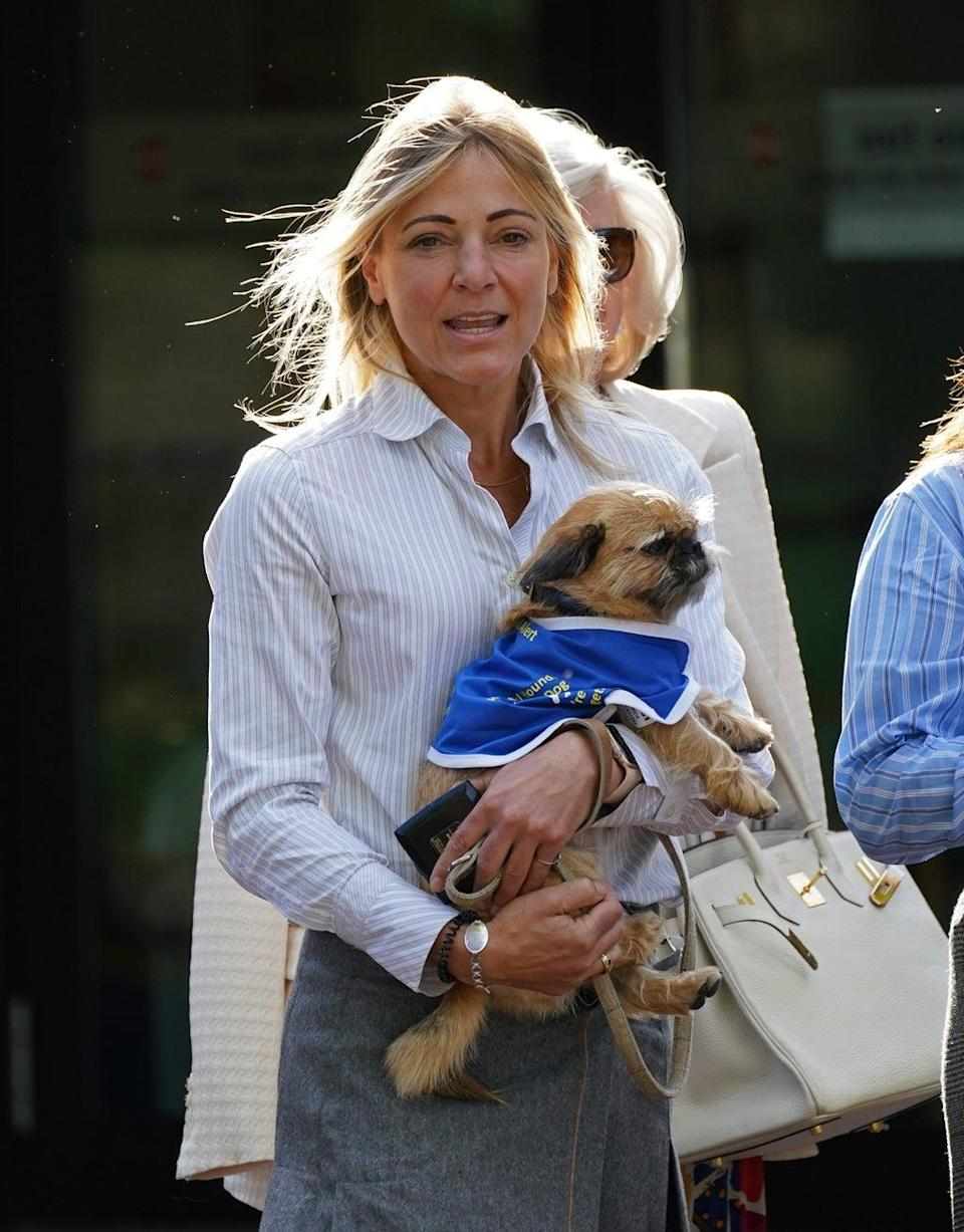 Phillipa Copleston-Warren leaves Isleworth Crown Court in west London, with her support dog (Yui Mok/PA) (PA Wire)