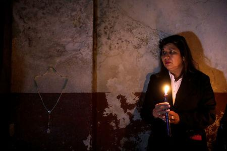Candles are lit during a vigil for victims after a fire broke at the Virgen de Asuncion home in San Jose Pinula on the outskirts of Guatemala City