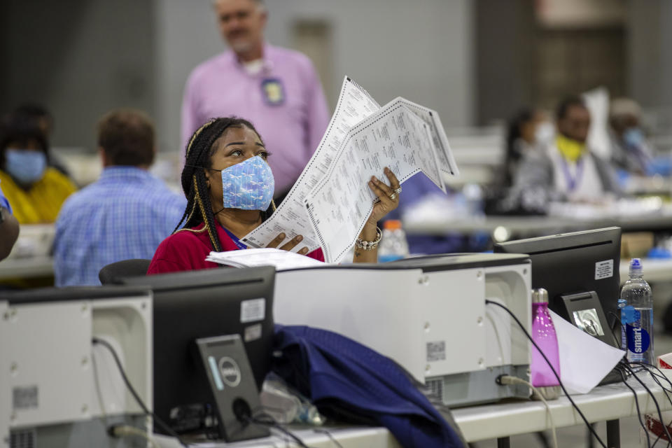 Fulton County employee Shaye Moss scans mail-in paper ballots at the Georgia World Congress Center during the Georgia primary elections in Atlanta on Tuesday, June 9, 2020. (Alyssa Pointer/Atlanta Journal-Constitution via AP)