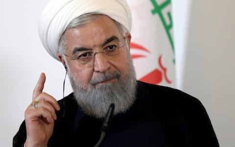 Iranian president Hassan Rouhanihas come under increasing pressure from hardline opponents over his handling of the economic crisis - Credit: Lisi Niesner/Reuters