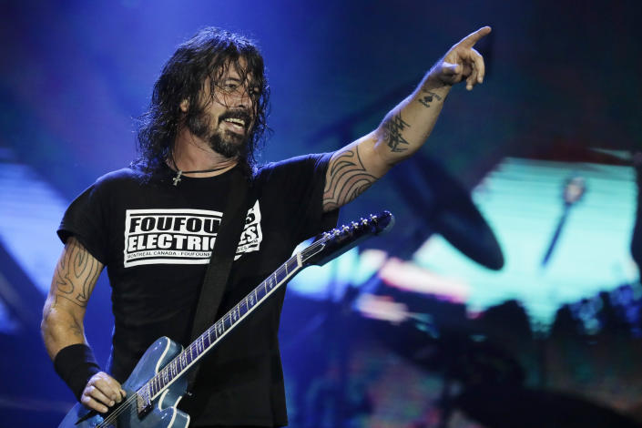 FILE - In this Sept. 29, 2019, file photo, Dave Grohl of the band Foo Fighters performs at the Rock in Rio music festival in Rio de Janeiro, Brazil. The band made this year's list of honorees to the Rock and Roll Hall of Fame. The ceremony, to be held at the Rocket Mortgage Fieldhouse in Cleveland, will be simulcast on SiriusXM and air later on HBO.. (AP Photo/Leo Correa, File)