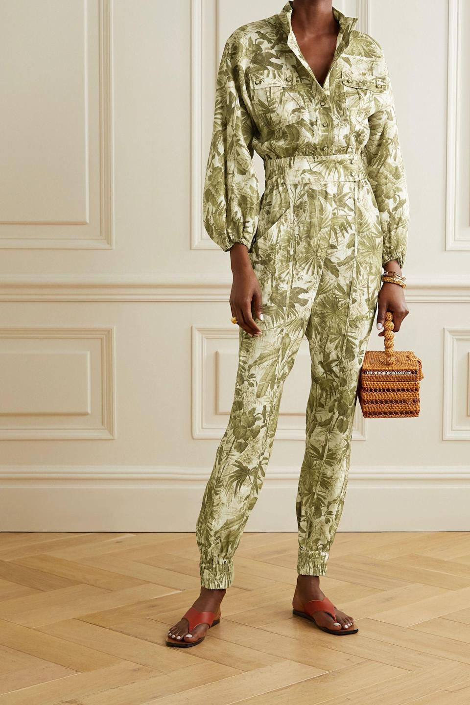 """<p><strong>ZIMMERMANN</strong></p><p>net-a-porter.com</p><p><strong>$570.00</strong></p><p><a href=""""https://go.redirectingat.com?id=74968X1596630&url=https%3A%2F%2Fwww.net-a-porter.com%2Fen-us%2Fshop%2Fproduct%2Fzimmermann%2Fclothing%2Ffull-length%2Fbrighton-printed-linen-jumpsuit%2F23471478575737622&sref=https%3A%2F%2Fwww.cosmopolitan.com%2Fstyle-beauty%2Ffashion%2Fg36618322%2Fnet-a-porter-spring-sale-2021%2F"""" rel=""""nofollow noopener"""" target=""""_blank"""" data-ylk=""""slk:Shop Now"""" class=""""link rapid-noclick-resp"""">Shop Now</a></p><p>Jumpsuits are a gift from the fashion gods, truly. I mean, who knew you could look freakin' bomb while wearing just a single article of clothing?? This work of art by Zimmermann is a testament to that and will be absolutely fire on that upcoming island vacay.</p>"""