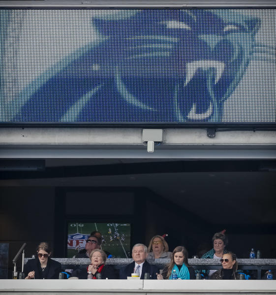 Carolina Panthers' team owner Jerry Richardson, middle, sits next to his wife, Rosalind to the left, under the team logo and with other guests in his suite during the first half of an NFL football game against the Green Bay Packers in Charlotte, N.C., Sunday, Dec. 10, 2017. The Panthers won 31-24. (AP Photo/Bob Leverone)